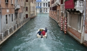 Admire the famous Venetian canals