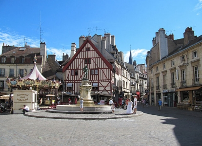 Beaune and its Hospices and colorful rooftops are part of most cycling tours