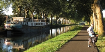 Biking along the Canal de Garonne, on the traffic-free bikeway.