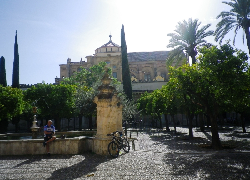 Relaxing in La Mezquita\'s garden in Cordoba, before tackling Andalusian hills