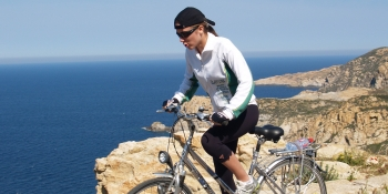 Cycling along the sea on the Cap Corse