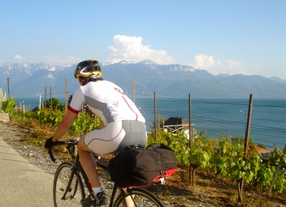 Riding up through Swiss vineyards with Lake Geneva in the background