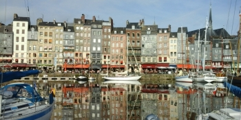 The charming harbor of Honfleur is on your way from Bayeux to Rouen