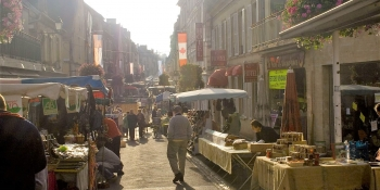 Cycle through Bayeux, Arromanches, and Caen to discover their local market